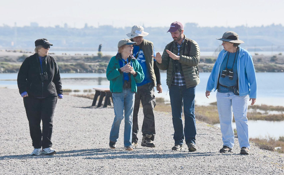 Bird Rescue volunteers join IBR's Executive Director JD Bergeron, second from right, during a bird watching trip to Bolsa Chica Ecological Reserve.